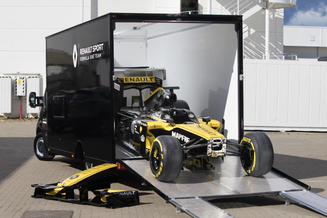Unloading Renault F1 car from van transporter