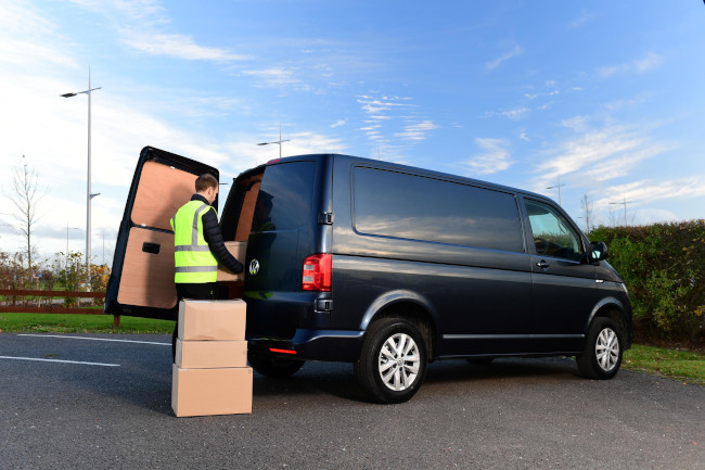 Man loading boxes into a van.